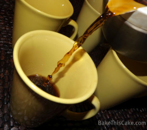 Pour coffee into vintage mustard coffee cups by bake this cake
