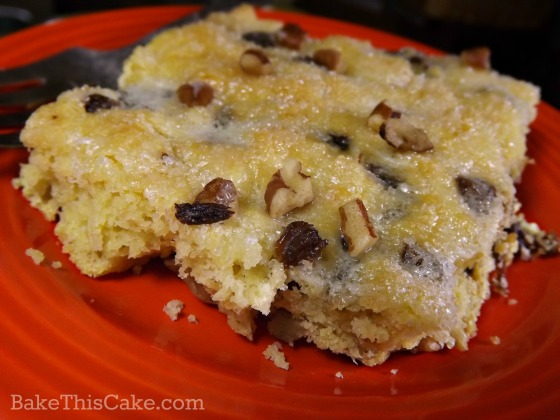 d german coffee cake recipe on an orange fiesta plate by bake this cake