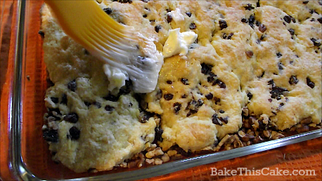 spreading german coffee cake with butter by bake this cake
