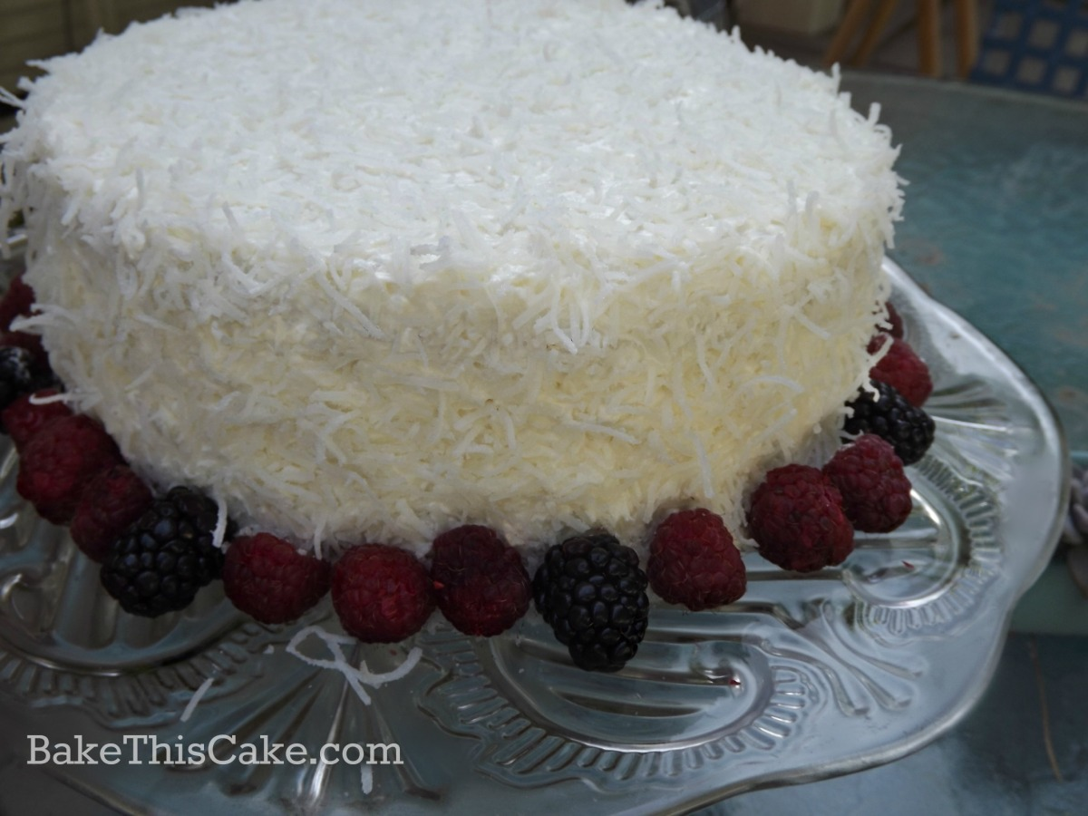 Homemade Coconut Cream Cake with fresh berries by bake this cake