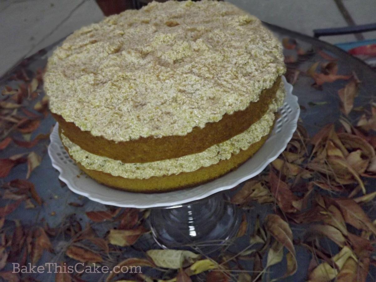 1912 pumpkin spice cake with pumpkin custard frosting by bakethiscake