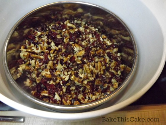 Draining nuts and fruits for modern sweet election day cake by bakethiscake