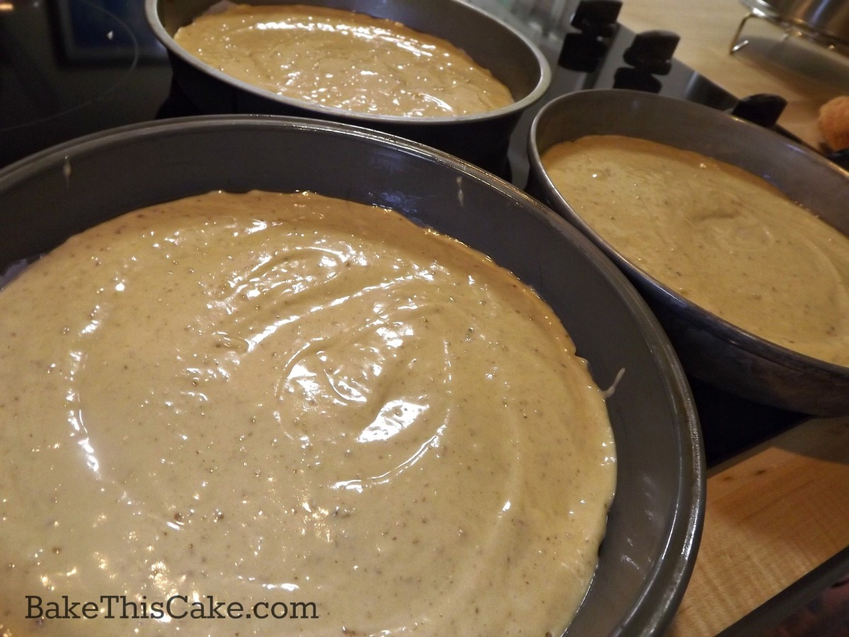 Maple Syrup Cake batter spread evenly between 3 cake pans by bakethiscake