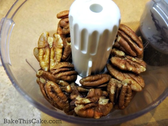 Pecans ready to chop finely for old fashioned maple cake recipe by bakethiscake