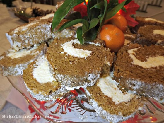 Vintage sweet potato roll cake sliced on a cake platter by BakeThis Cake com