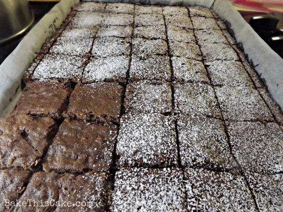 light sprinkle of powdered sugar for boozy brownies by bakethiscakeco